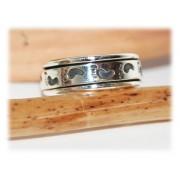 Bague anneau tournant petits pieds argent massif