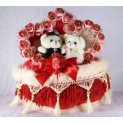 Beautiful Love Couple Teddy Bears Sitting on a Decorated Heart Cushion