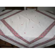 Vintage hand embroidered Romanian tablecloth on linen