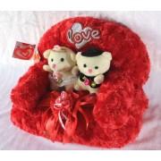 Valentine Love Couple Teddy Bears sitting on a plush Sofa