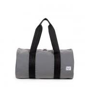 Skládací víkendová reflexní taška Herschel Packable stříbrná