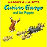 Curious George and the Puppies by Rey