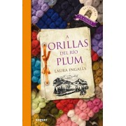 A Orillas del rio plum / On the Banks of Plum Creek by Laura Ingalls Wilder