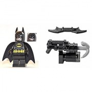 The LEGO Movie - Batman Minifigure with Dual-sided Face (Smiling and Scowling) with Batarang and Harpoon Gun from set 70