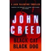 Black Cat Black Dog by John Creed
