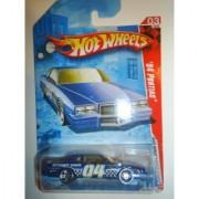Hot Wheels 2010 '' '84 PONTIAC STUNT CAR RACE WORLD - MOVIE STUNTS - 03 of 04 - 175/240 - Dark Blue - White Interior - Yellow Tinted Windshield - Graphics on side are 04/STUNT CAR/ HD CAMERA/ HW / HOT WHEELS & CHECKERBOARD DESIGN REAR SPOILER