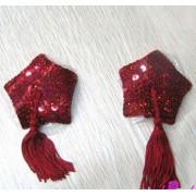 Copricapezzoli rossi con paillettes