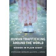 Human Trafficking Around the World: Hidden in Plain Sight, Paperback