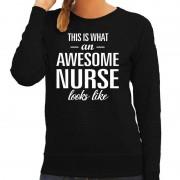 Bellatio Decorations Awesome nurse / zuster cadeau trui zwart voor dames XL - Feesttruien