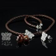 Cygni - Halsband med silver örhängen och berlock med fjäril form