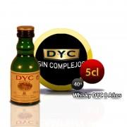 Botellita miniatura whisky DYC 8 años