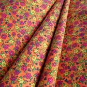 Narancssárga, színes virágos pamutvászon méteráru