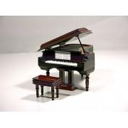 Miniatura piano de cola con música.