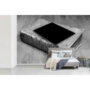 Fotobehang vinyl - Tablet ligt op een dik boek breedte 420 cm x hoogte 280 cm - Foto print op behang (in 7 formaten beschikbaar)