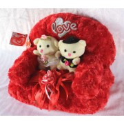 Valentine Love Couple Teddy Bears sitting on a plush Sofa