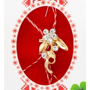 Martisor metalic, model Floare aurie cu pietricele