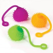Flashing Swing Balls - 4 soft, stretchy & spiky rubber balls that flash when swung. Size 14cm, ball 45mm diameter