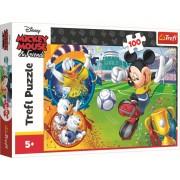 Puzzle Trefl 100 piese - Mickey Mouse pe terenul de sport