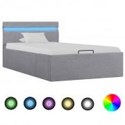 vidaXL Легло с повдигащ механизъм с LED светлосиво текстил 100x200 см