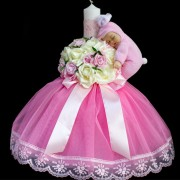 Lumanare botez cu aranjament roz trandafiri si papusa somnoros