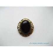 Broşă ovală aurie cu agat negru