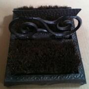Cast iron swurll shoe brush