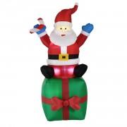 Надуваем, седящ върху подарък Дядо Мраз