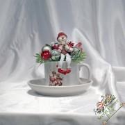 Cana cafea cu păpusa de zapada