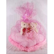 Valentine Couple Teddy Bears sitting on a pink plush heart covered with net