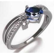 Prsten Agata z bílého zlata posetý 25ks diamanty a modrým safírem