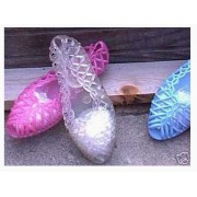 Three pair of the Original 80's Jellies, Two Pair Toddler's size 7 and one pair of size 8 to grow on. You will receive an assortment of Ice Clear, Lilac and Blue of the GO EVERYWHERE FUN VINTAGE JELLIE SHOES