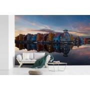 Fotobehang vinyl - Scandinavische stijl tijdens zonsondergang in Groningen breedte 450 cm x hoogte 300 cm - Foto print op behang (in 7 formaten beschikbaar)