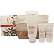 Clarins Body Care Presentset 200ml Moisture Rich Body Lotion + 30ml Hand And Nail Treatment Cream + 30ml Exfoliating Body Scrub + Necessär