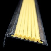 Žlutá hliníková schodová hrana s protiskluzovým páskem Antislip, FLOMAT - délka 300 cm, šířka 5,3 cm a výška 2 cm