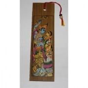 A beautiful pattachitra screen printed book mark made of palm leaf depicting Radha and krishna.