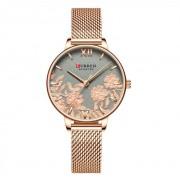 CURREN Damski zegarek CURREN na bransolecie w kolorze różowego złota